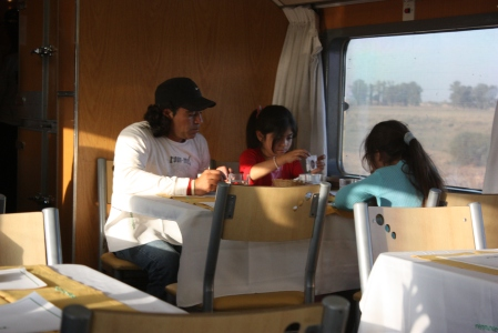 A family group breakfasts in the dining car