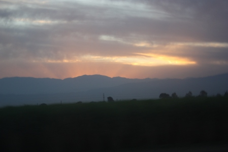 The sun sets behind the Andes